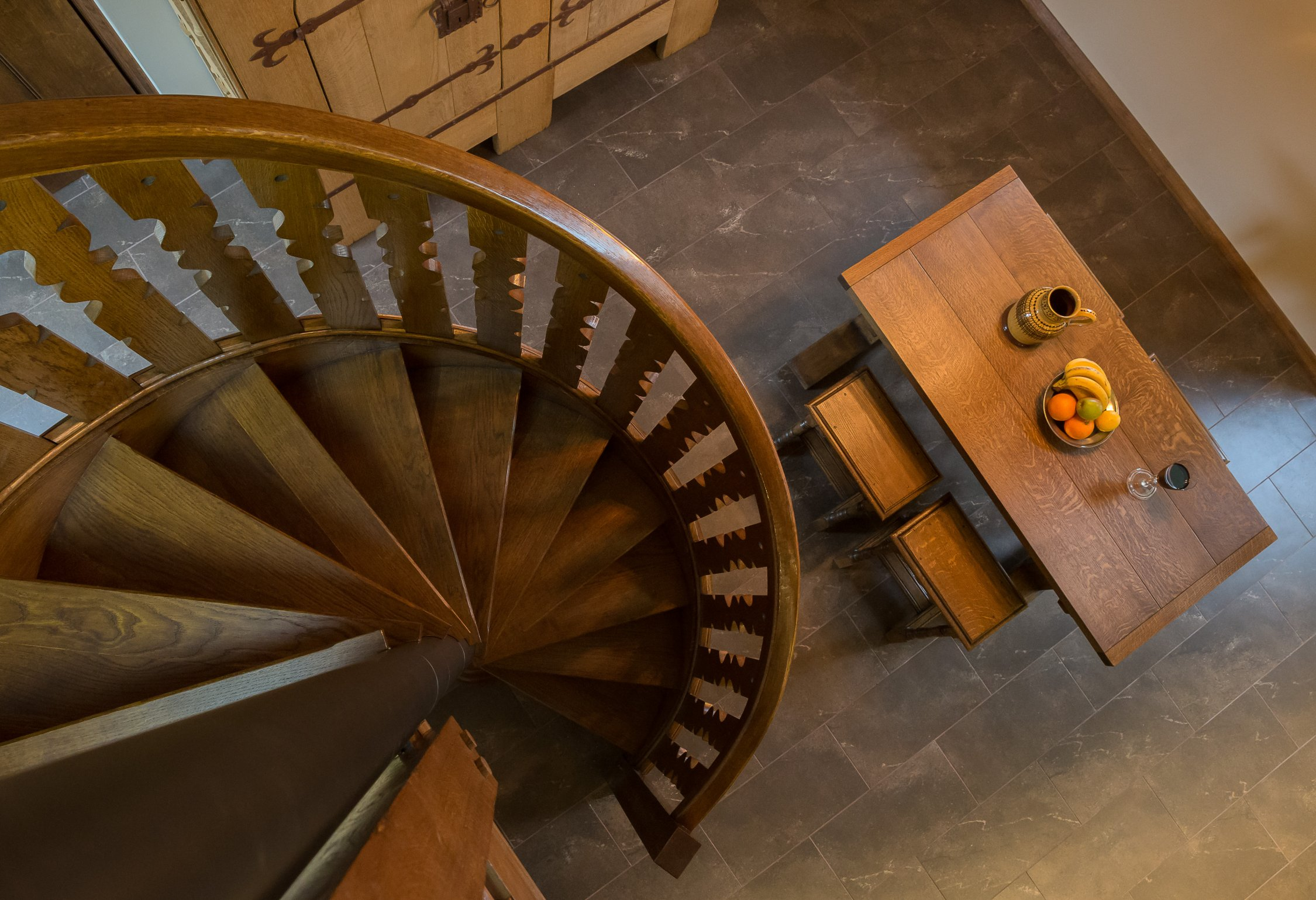 View down the oak spiral staircase to Kitchen