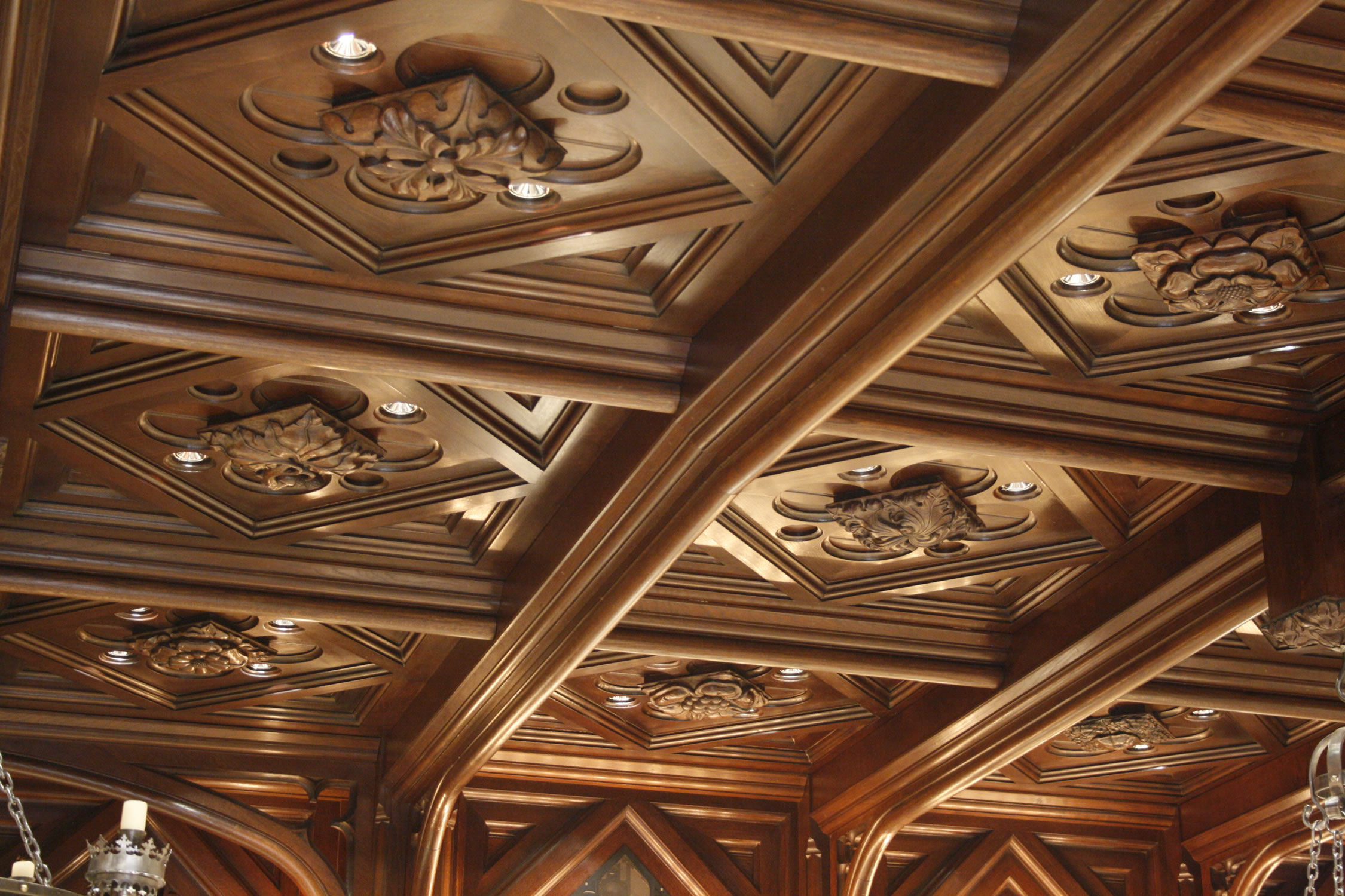 Soild oak ceiling with integrated lighting and audio equipment