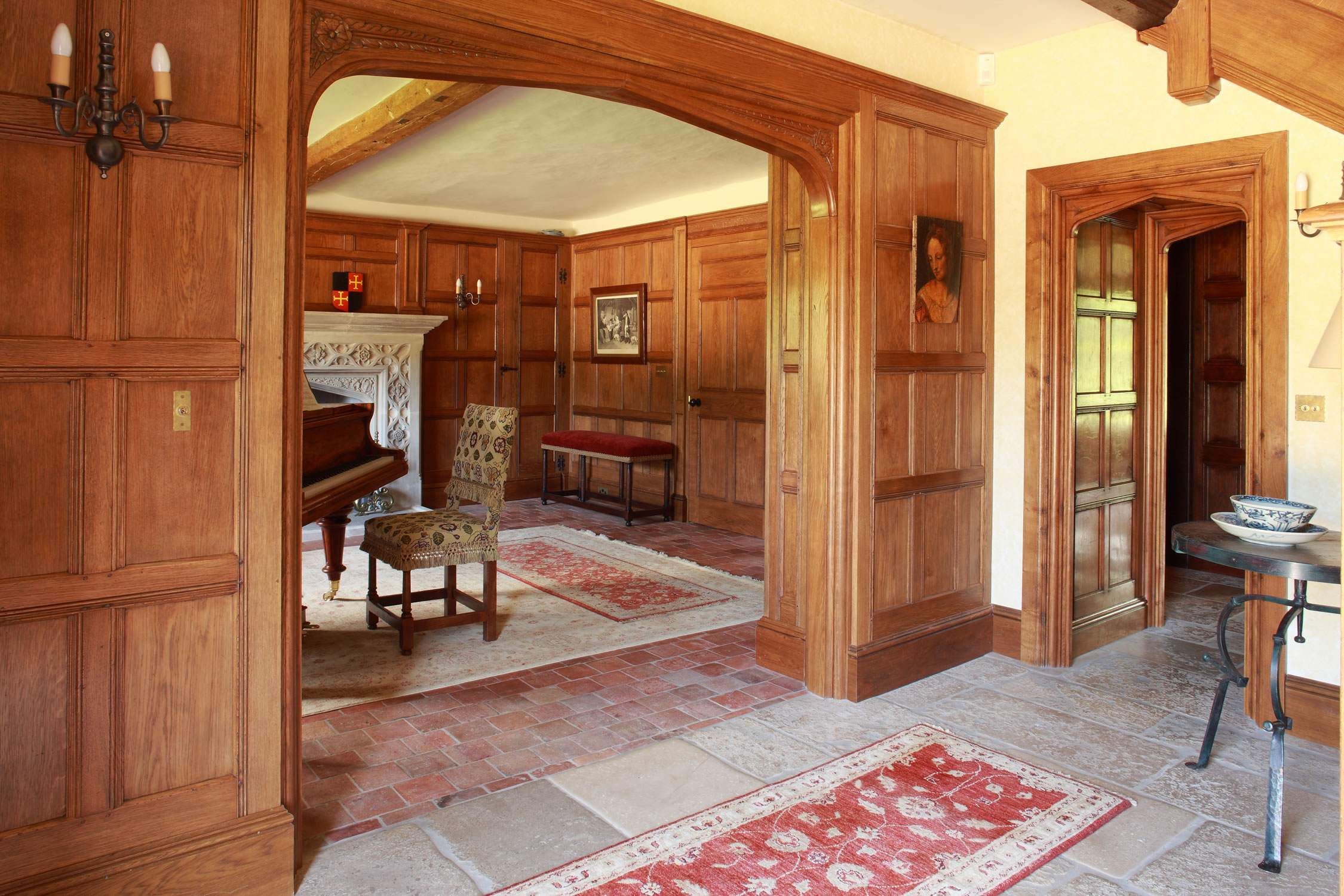Tudor style oak panelling for the piano hall