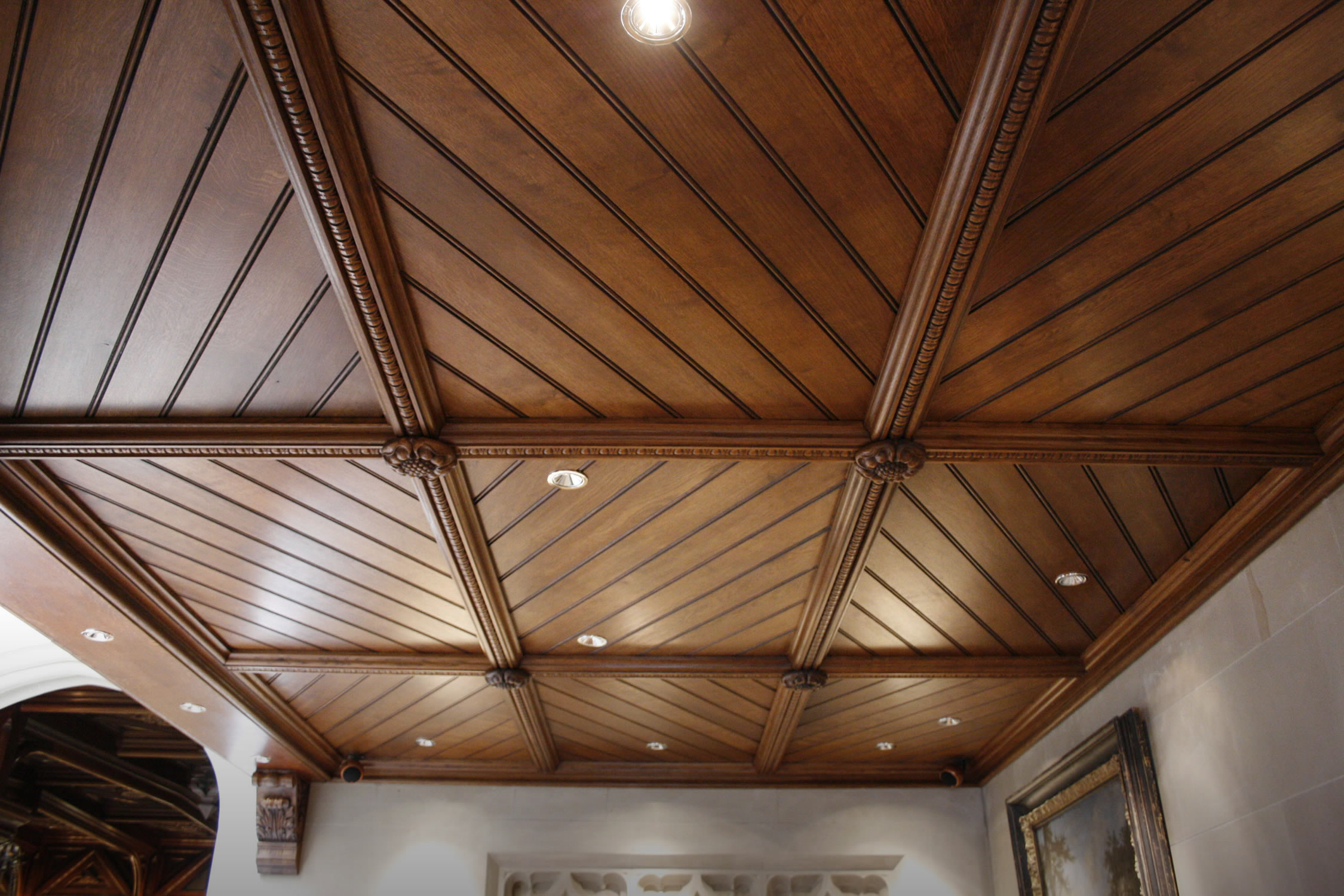 Oak ceiling with hand carved boss detail