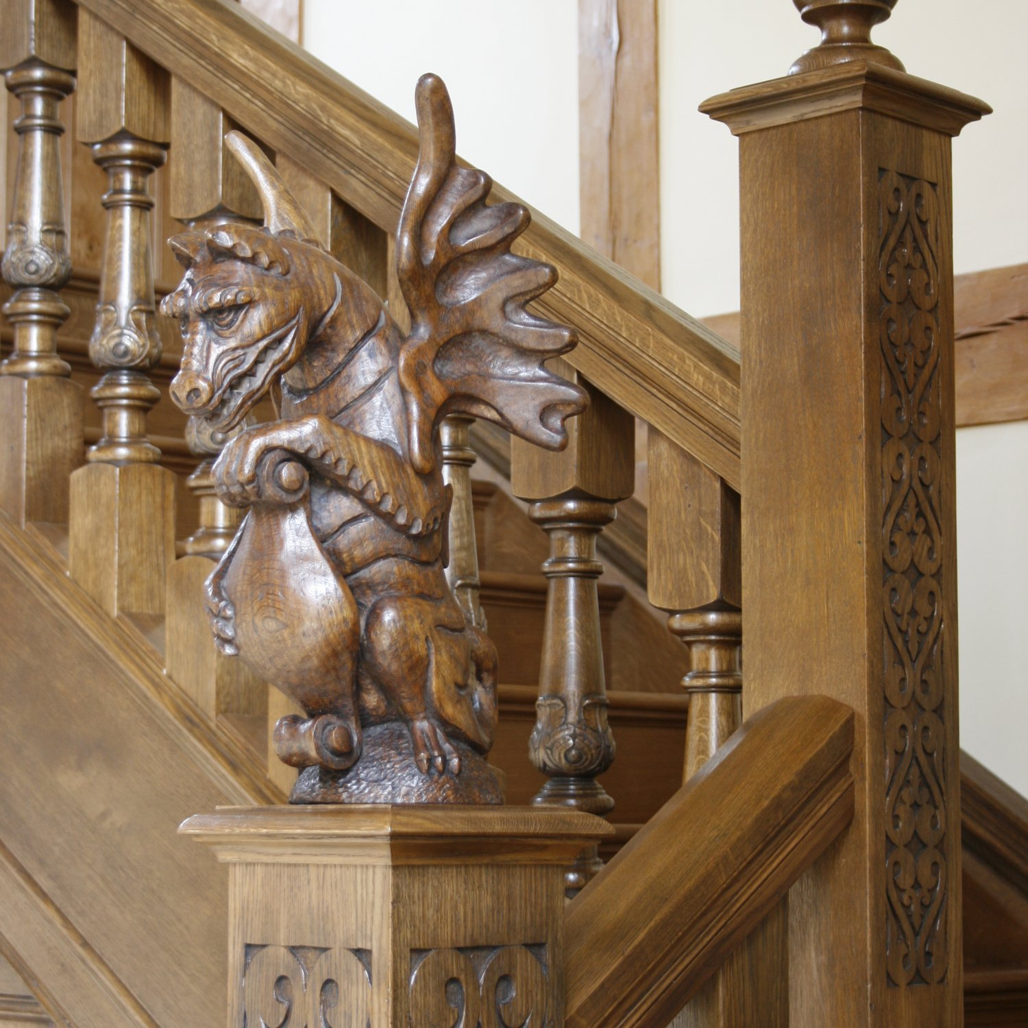Detail of hand carved dragon finial in solid oak