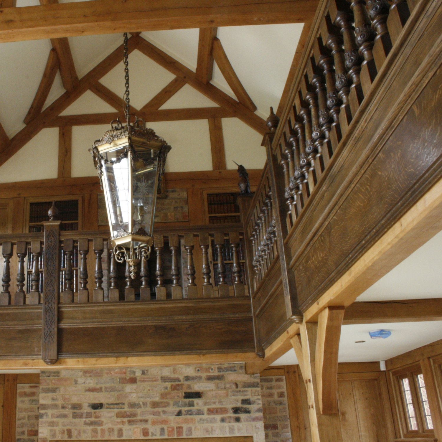 Solid oak gallery with hand carved balusters