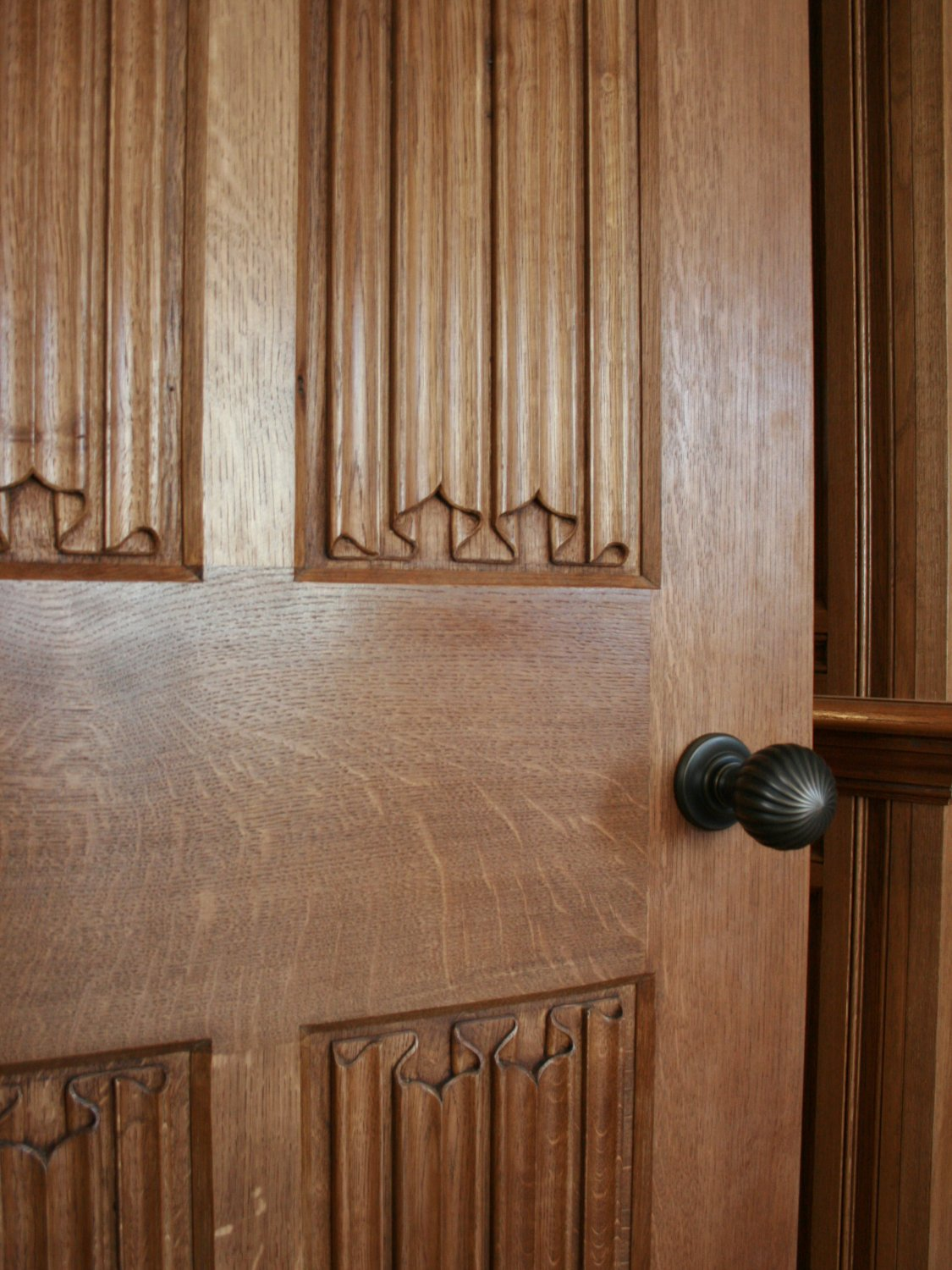Oak library door with carved linenfold panels