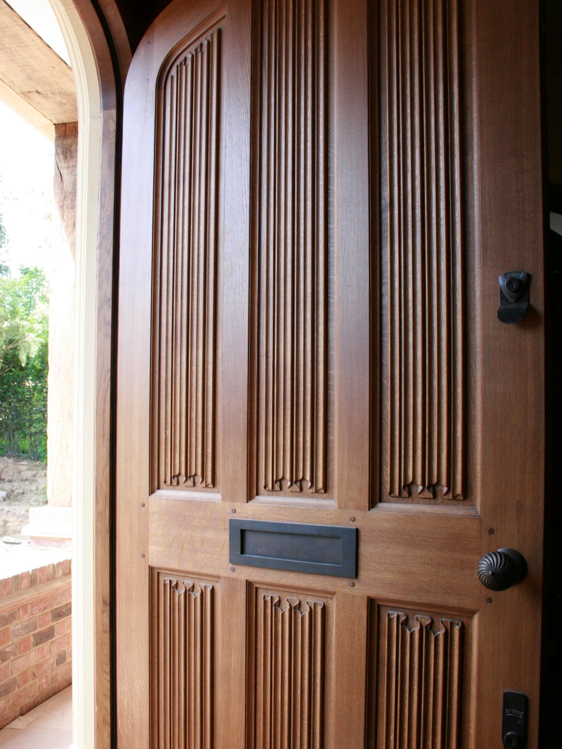 Hand carved oak entrance door with linenfold panels