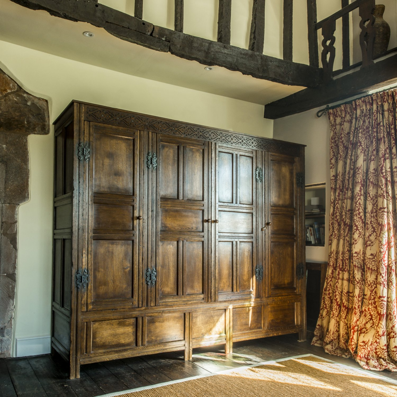 Hand carved bespoke oak wardrobes for the Master Bedroom