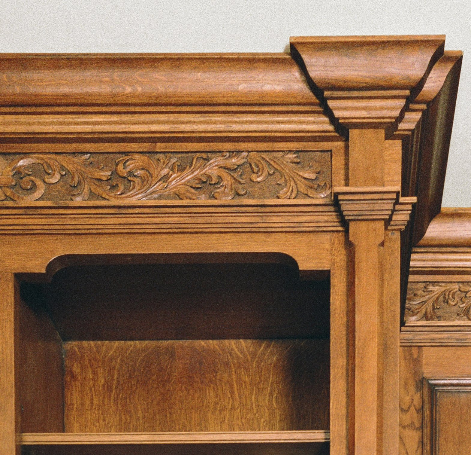 Hand carved detail in the oak Library