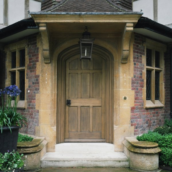 Solid arched oak entrance door