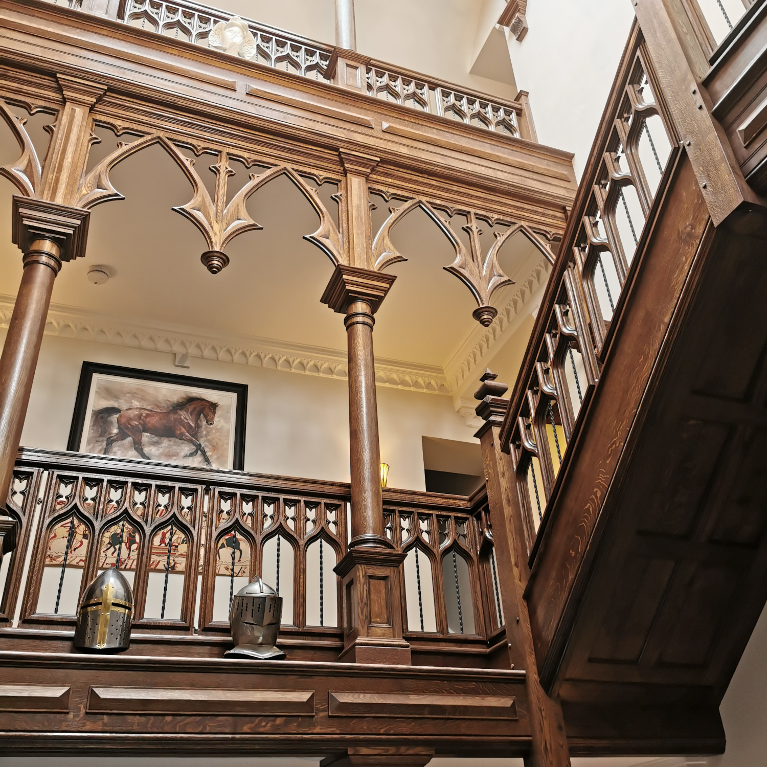 Solid oak Gothic style staircase with double height gallery