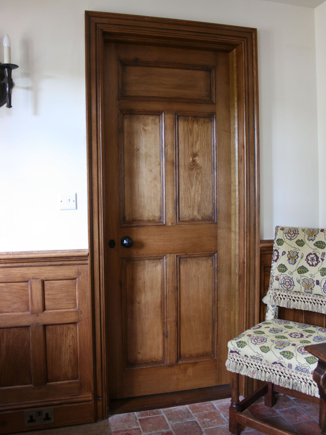 Oak panelled door, architave and dado panelling