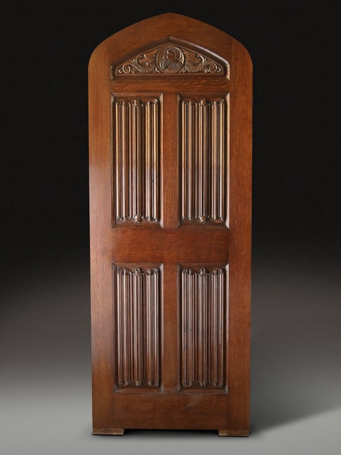 Hand carved oak door, with C16th style linenfold decoration