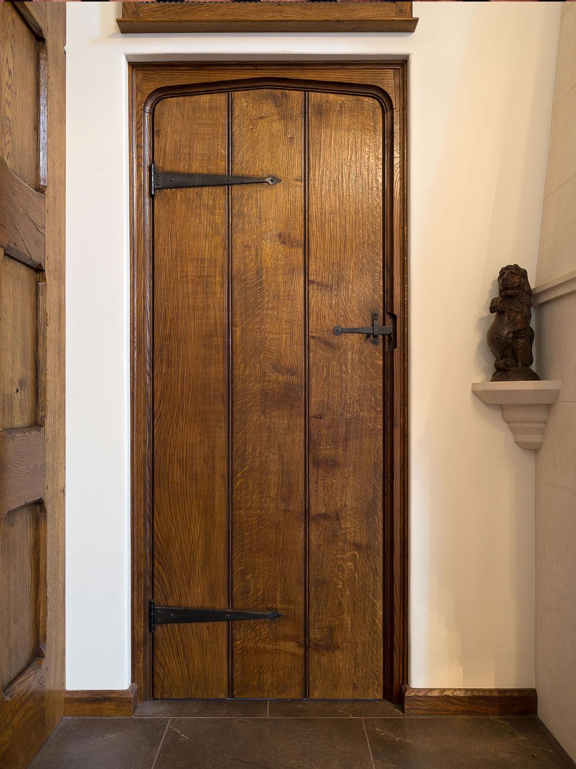 Tudor arched solid oak planked door