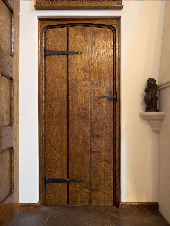 Tudor arched solid oak planked door