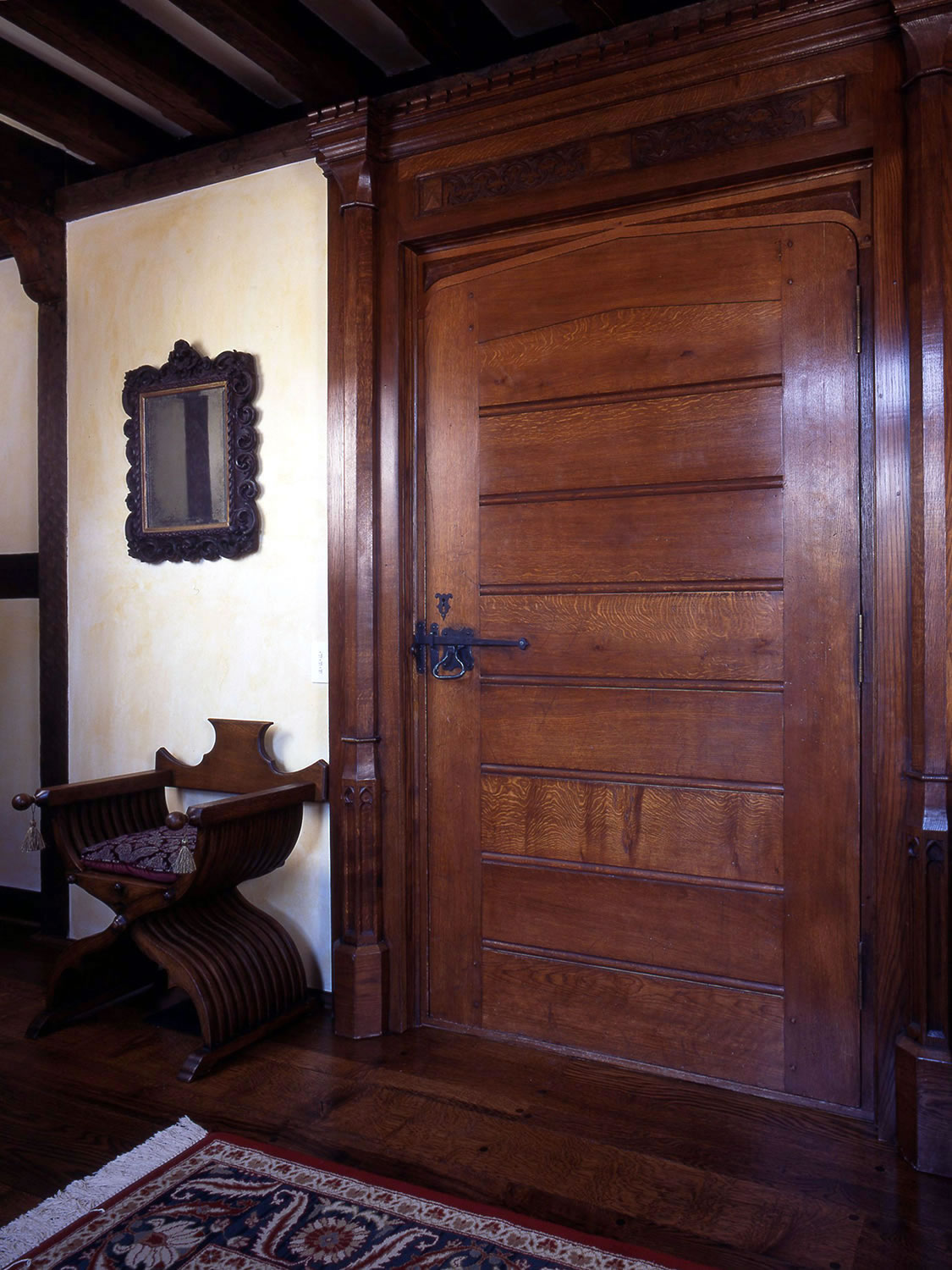 C16th style soild oak door with hand-carved surround