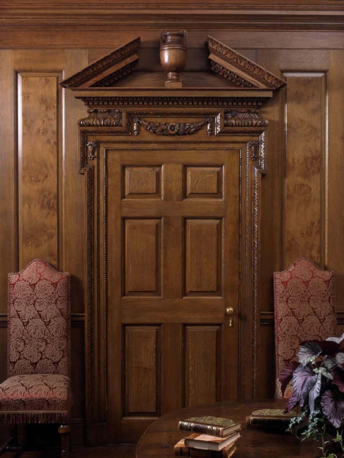 Georgian style oak door, with decorative hand-carved pediment