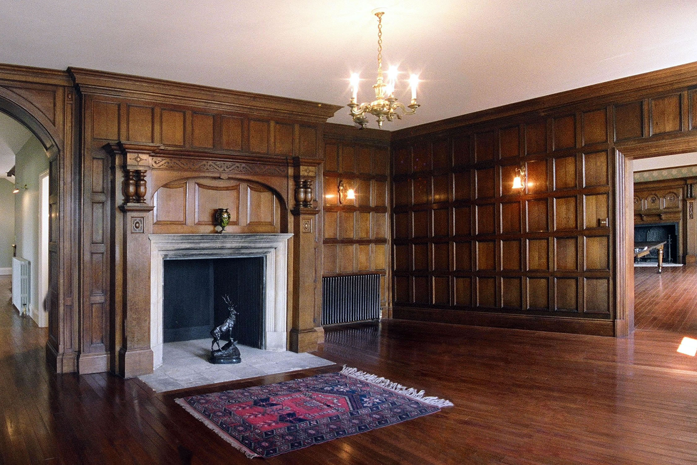 Arts & Crafts style oak panelling and fire surround