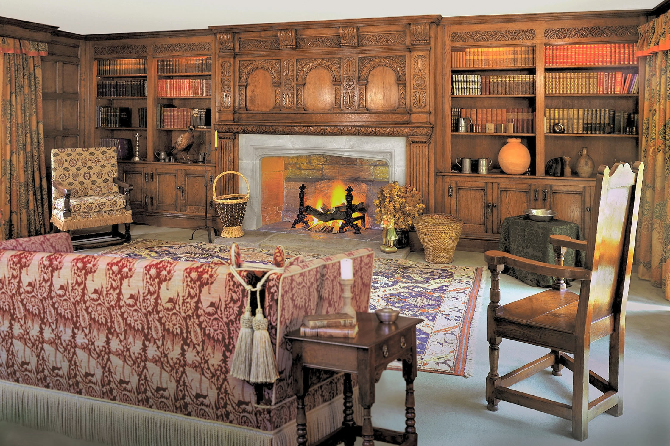 C17th style hand carved oak overmantle and bookcases