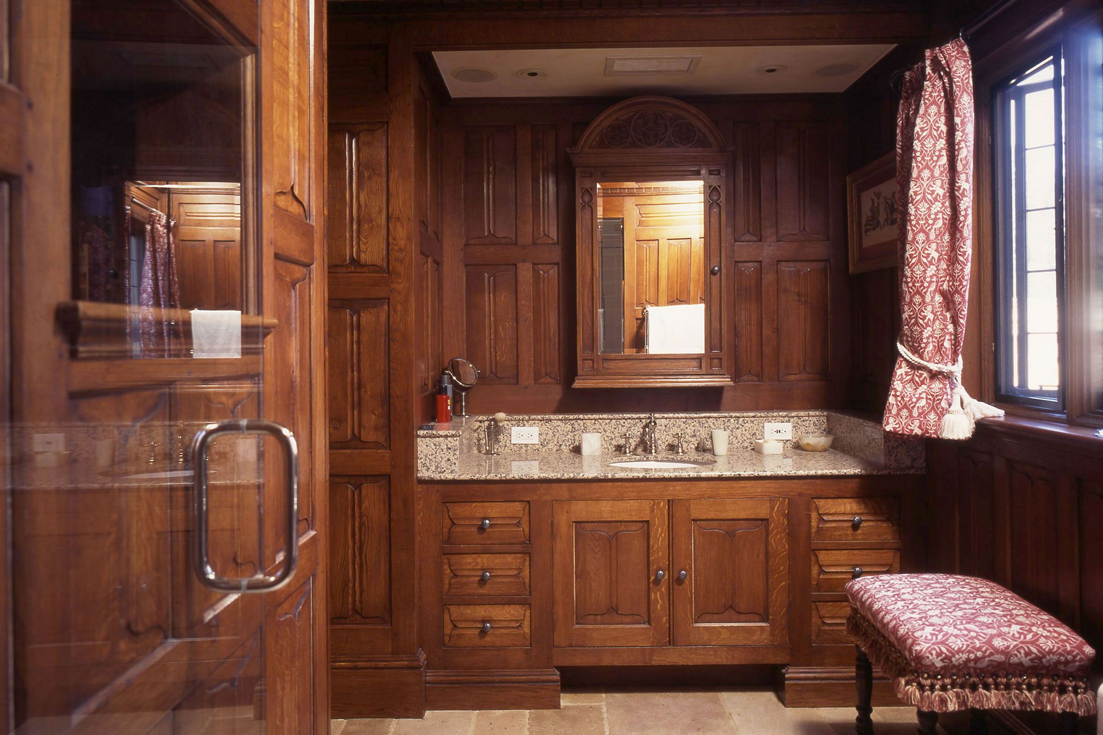 Oak panelled bathroom, hand-carved parchemin design