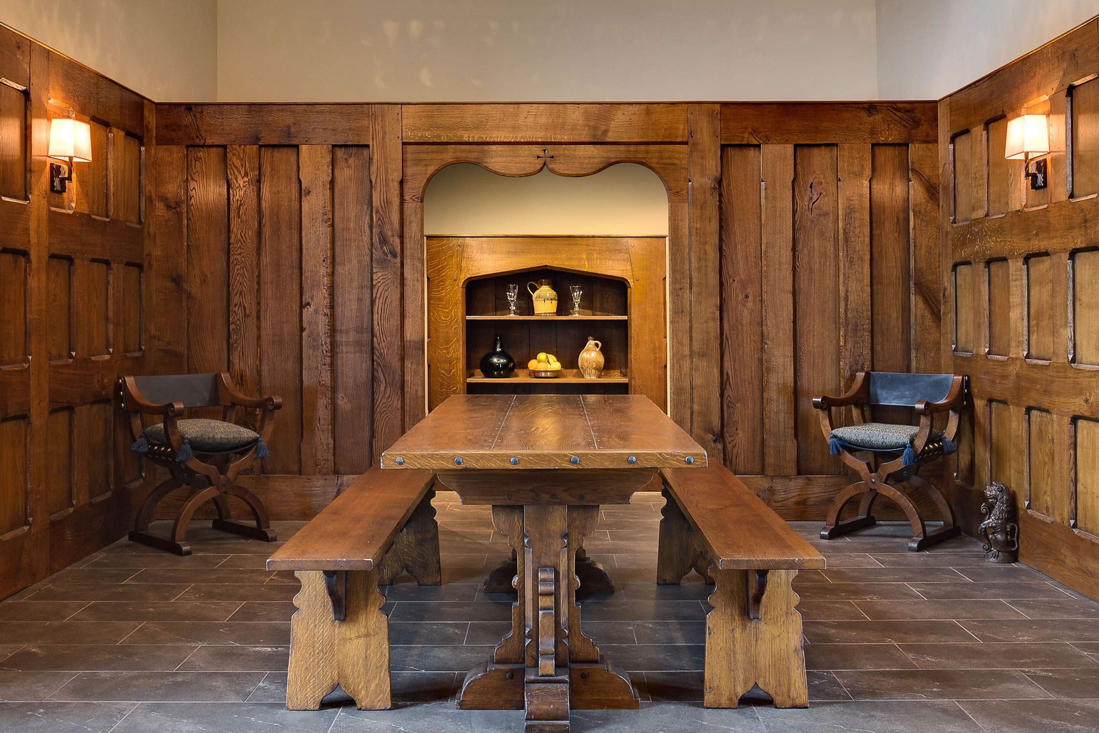 Plank & muntin style oak panelling and oak furniture for the Medieval style Dining Hall